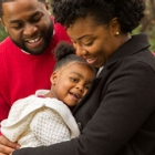 African American couple hugging and embracing each other and their young daughter