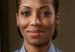 African American female firefighter smiling and facing the camera